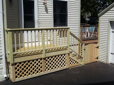 Porch with a dog-proof gate.