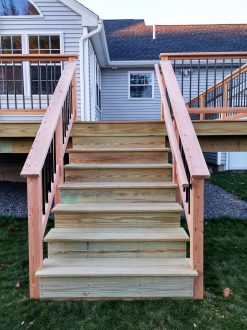 The deck had a single set of 4 foot wide stairs to the backyard. I milled a handrail from Douglas fir to match the guardrail.