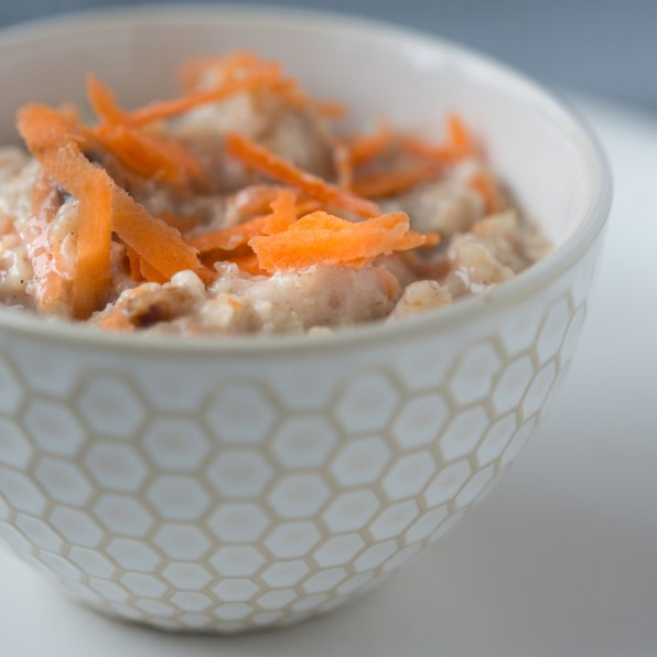 a small bowl of porridge with carrot on top
