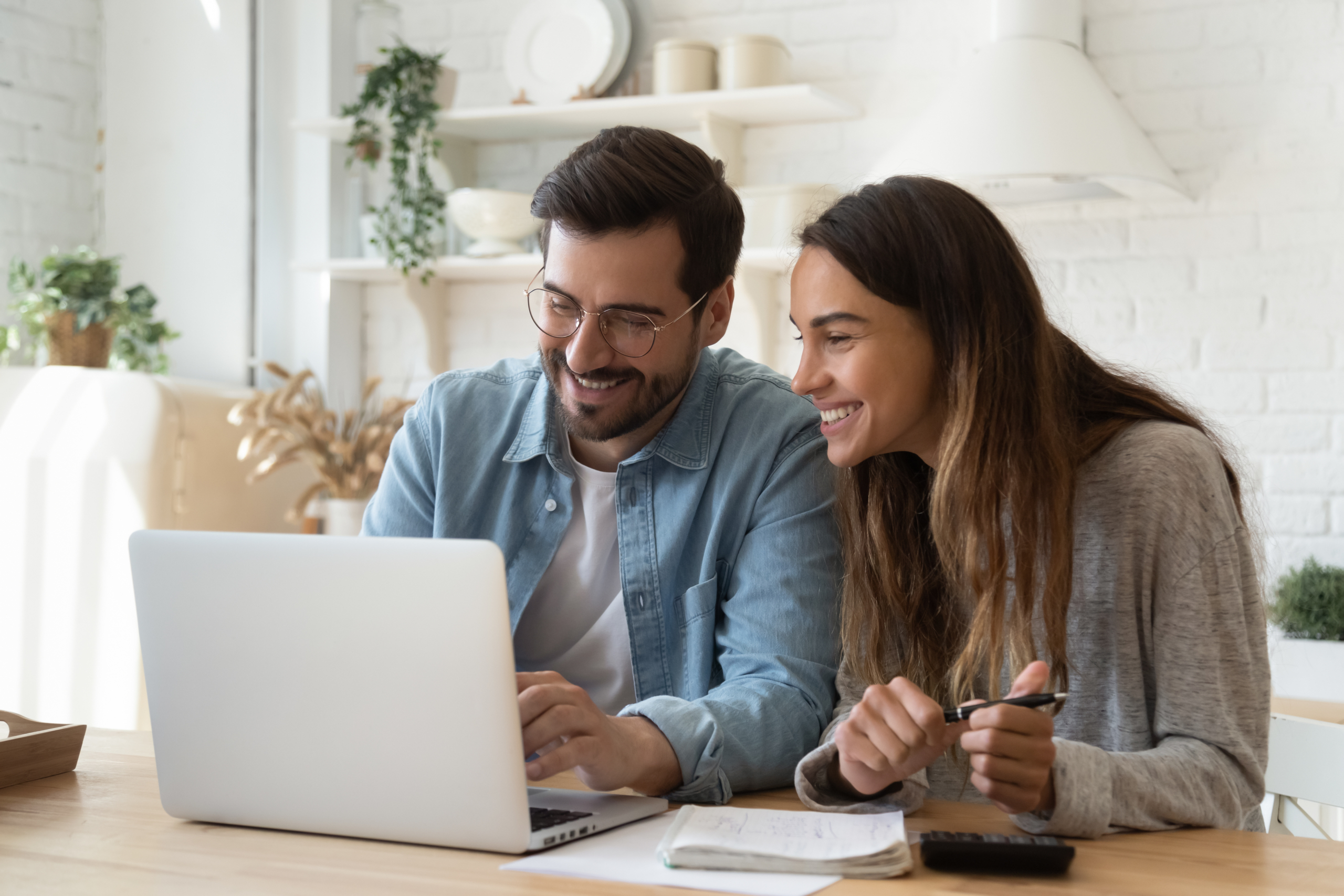 This is a picture of a happy couple having online therapy.
