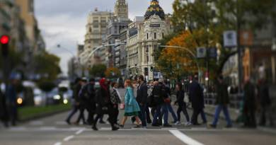 people-crossing-street-madrid-spain