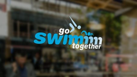 Go Swimm logo on glass