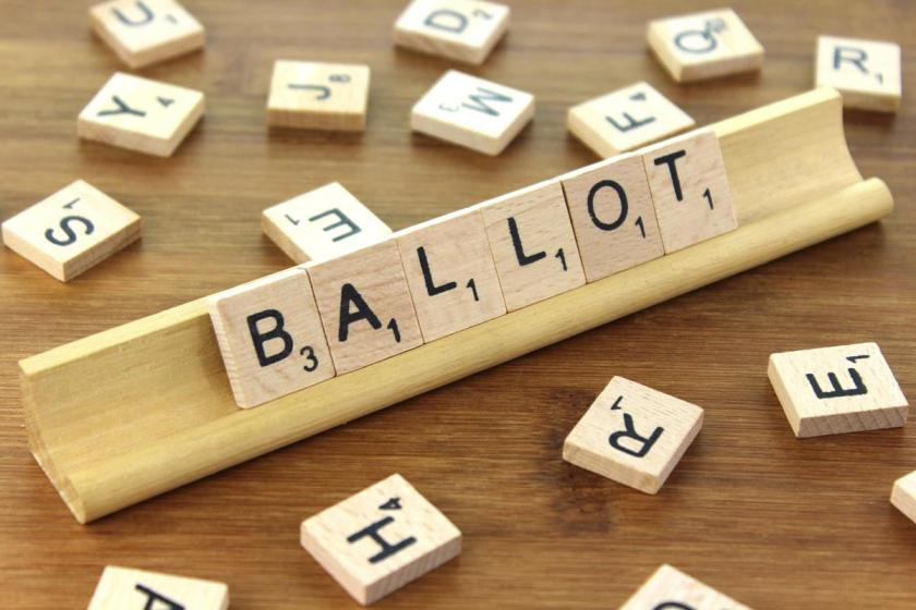 Scrabble letters spelling out 'ballot'