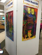This large column displaying student work is directly ahead upon entering the library!