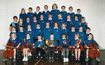 The school orchestra with Miss Beadle 2000.