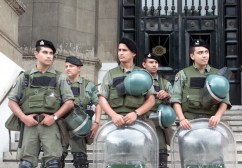 Argentine paramilitary police take position in front of the Supreme Court building to prevent riots, January 4, 2002. President Eduardo Duhalde confirmed that Argentina will devaluate its peso and urged shopkeepers not to increase prices, amid fears of further outbreaks of the rioting that brought down president Fernando de la Rua and his interim successor.  REUTERS/Andres Stapff --- Image by © Reuters/CORBIS