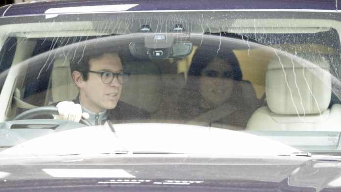 Princess Eugenie beams as she leaves hospital with new baby son and husband Jack Brooksbank