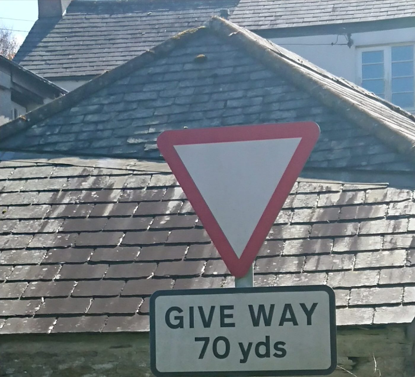 "Road sign saying ""give way in 70yds"" for the post How can I tell you to stop?"