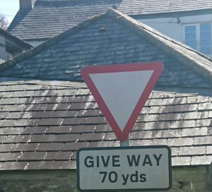 """Road sign saying """"give way in 70yds"""" for the post How can I tell you to stop?"""