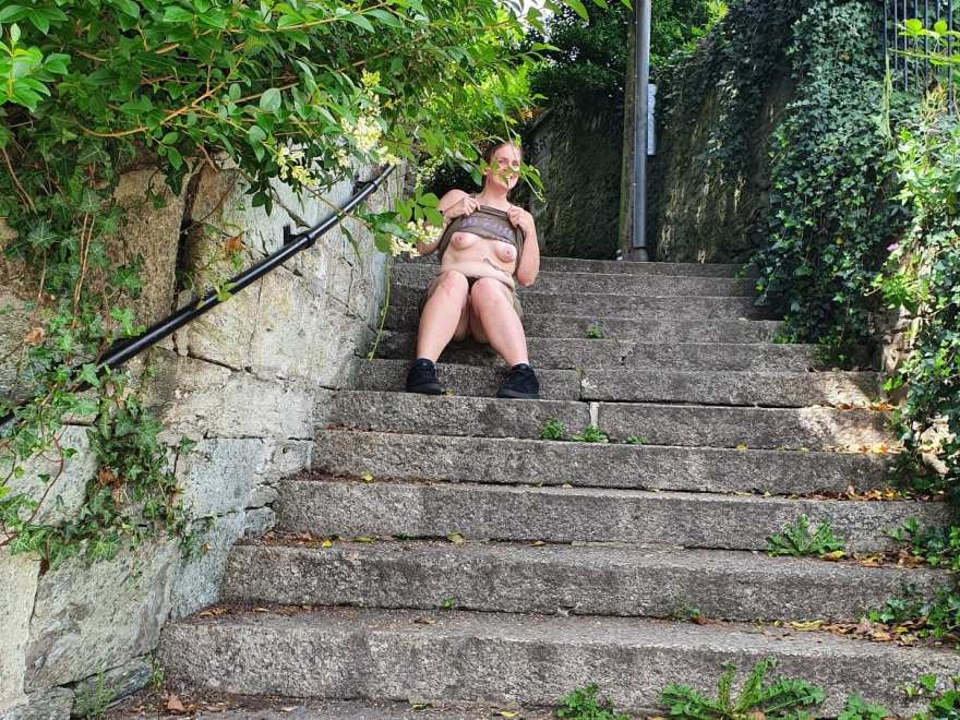 Lady sitting on public steps exposing her breasts for the post Progress not perfection