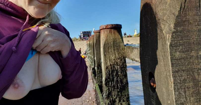 Barefoot sub has her breasts out at the Groyne