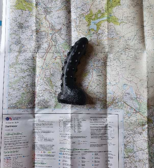 Dildo showing the direction on a dartmoor map for toys in the wild: planning