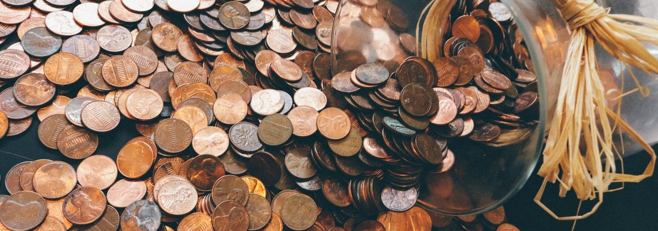 pennies spilt all over the floor for getting creative to make ends meet