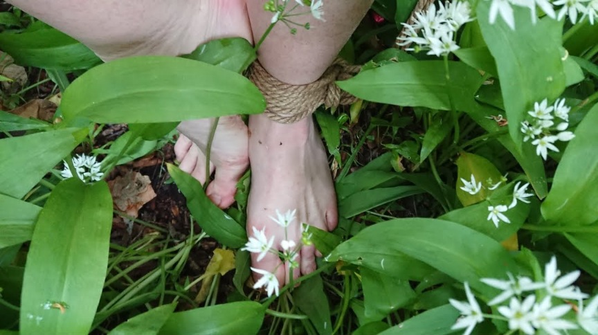 Barefoot and not quite naked in nature.