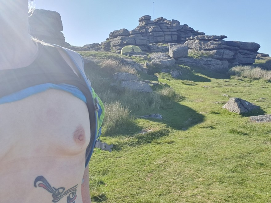 Breasts exposed atop Great Mis Tor for wild camping on Dartmoor. A sunny evening, a 2 man tent and boobs!
