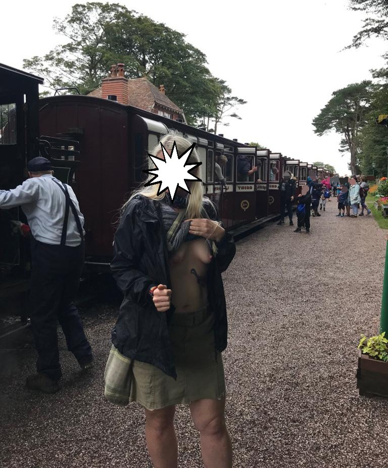The tourist Attraction all round header image shows me subtly exposing my breasts on a busy train station platform, with the steam train and other passengers in the background.