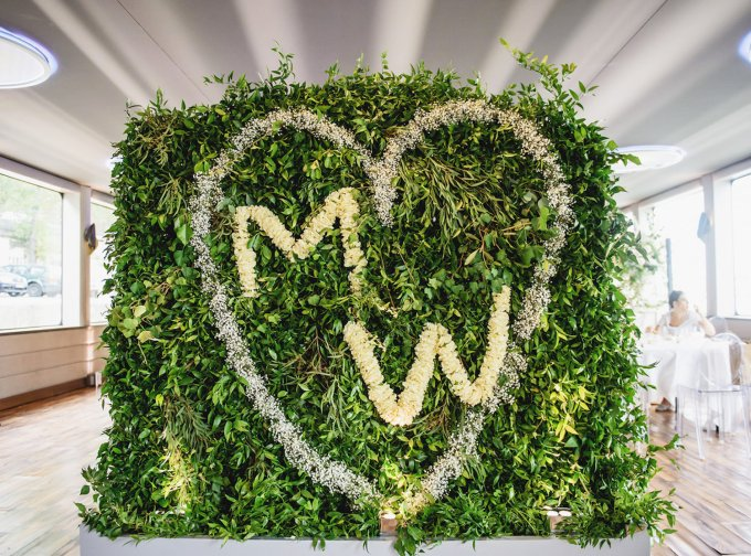 floral-wall-with-couple-monogram-for-welcome-party