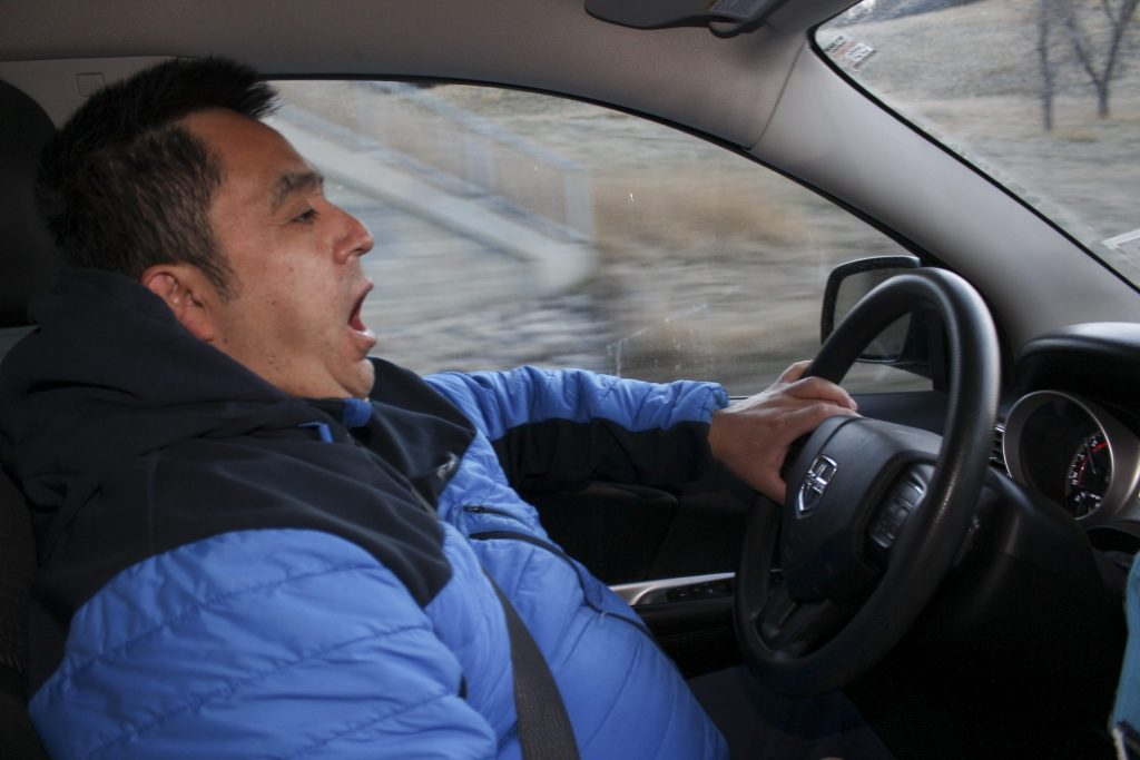 Francisco Melgar yawns while driving on Memorial Drive to his cleaning job at Bottlescrew BillÕs, a restaurant and bar in downtown Calgary on April 15, 2021. Melgar, 55, has been cleaning in restaurants since he first arrived in Calgary from El Salvador in the 1980Õs. He has had to wake up at varying times throughout the years, depending on the restaurant and bar he cleaned (Photo by Alejandro Melgar/SAIT)