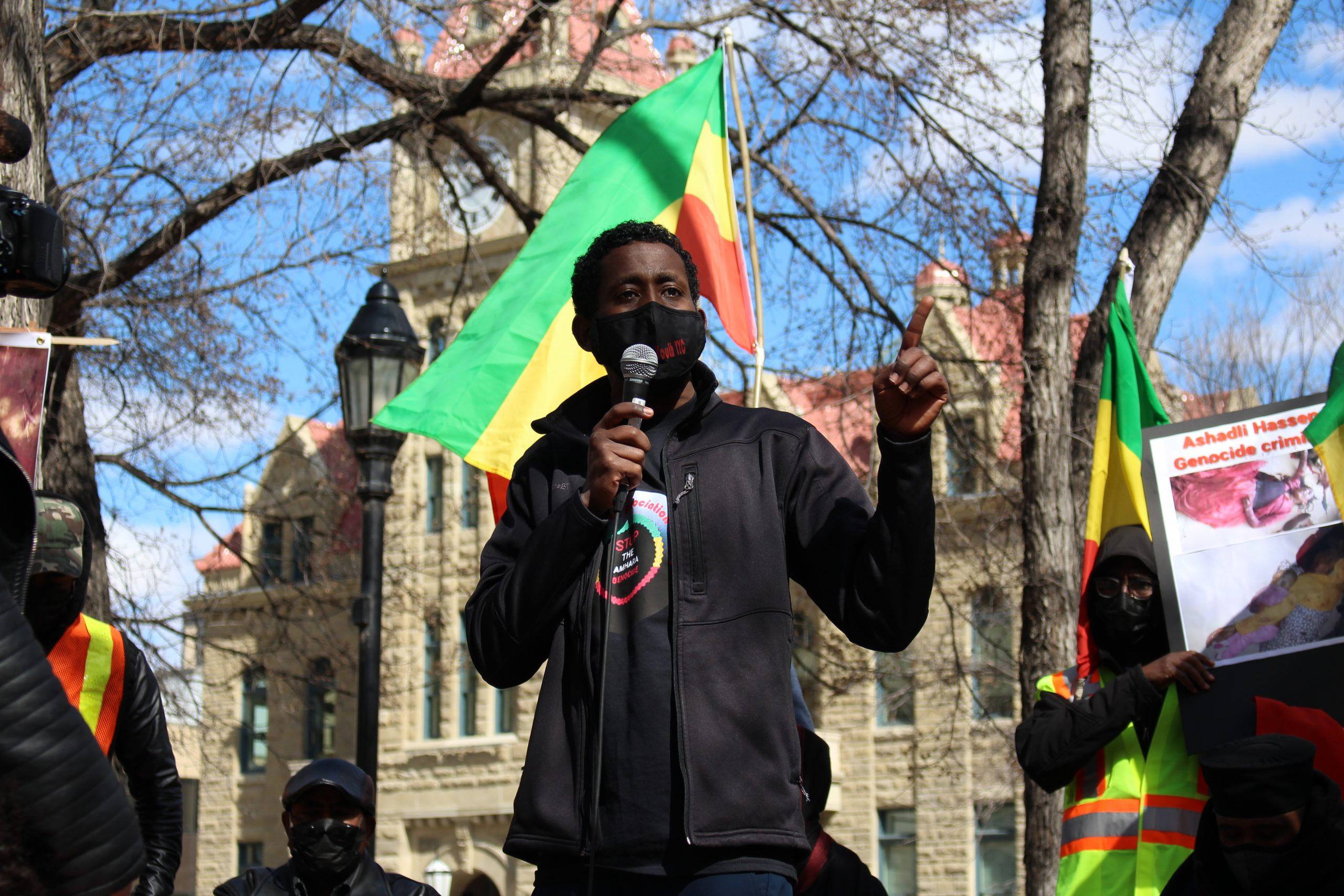 Elias Haile speaks in Amharic to a group of protestors in Olympic Plaza in Calgary on April 11, 2021. Haile is regularly active within the Amhara community, and he speaks out against the genocide of the Amhara people in Ethiopia. According to the Ethiopian Human Rights Council (EHRCO), there have been 1100 deaths due to the massacre from November 2020 till April 2021. (Photo by Alejandro Melgar/SAIT)