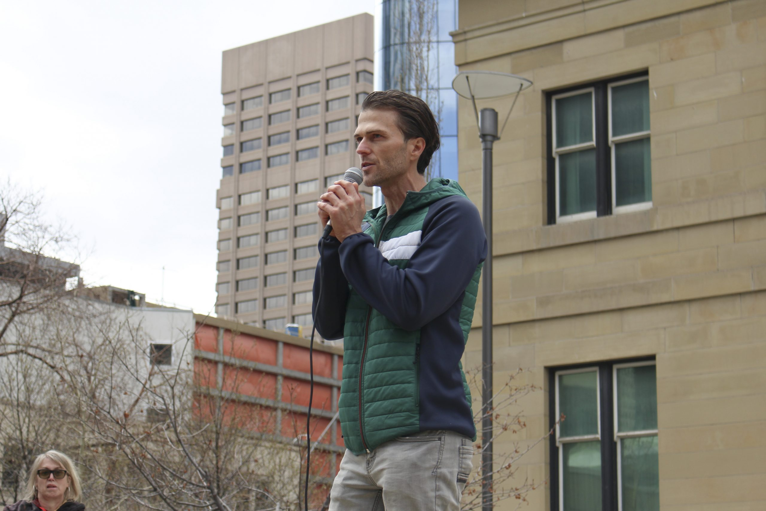 """Ryan Audette, the organizer for Calgary Freedom Central, spoke at the """"Save Small Business"""" rally taking place at Courthouse Park in downtown Calgary on April 11, 2021. Audette says that Calgary Freedom Central is different from the Walk for Freedom group in Calgary, and wants to inform people on the affect COVID-19 has had on businesses and people alike. In a Facebook post prior to the event, Audette says that people are to be kind and courteous to the media and anyone that is shooting photos, along with not bringing tiki torches or expressing any form of hatred. (Photo by Alejandro Melgar/SAIT)"""