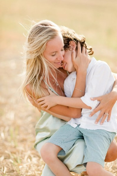 Mom and son moment in the golden hour during family photoshoot in Tuscany. Picture by Alessandro Taddeini.