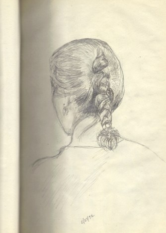 womans-braid-in-notebook