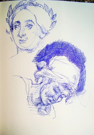 two drawings of heads notebook