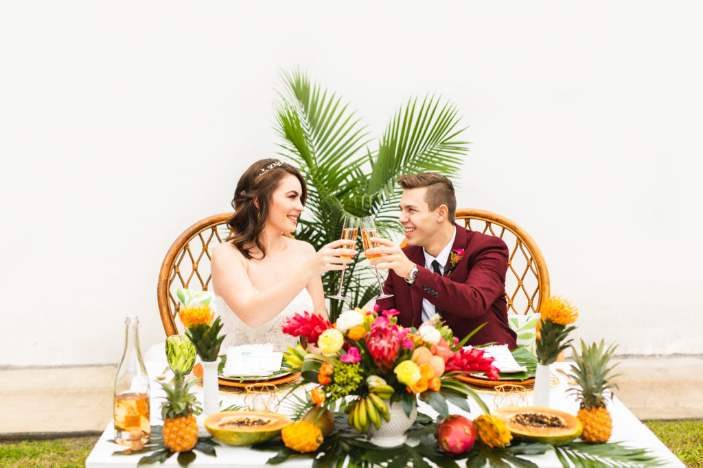 Brightly colored tropical inspired wedding styled shoot planned by Alexa Kay Events. See more creative wedding ideas at alexakayevents.com!