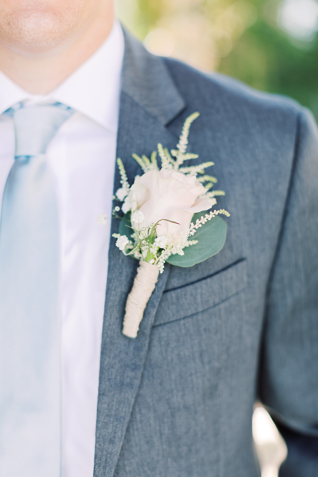 Wedding boutonniere: | Romantic blue Texas wedding at Spring Venue by Alexa Kay Events