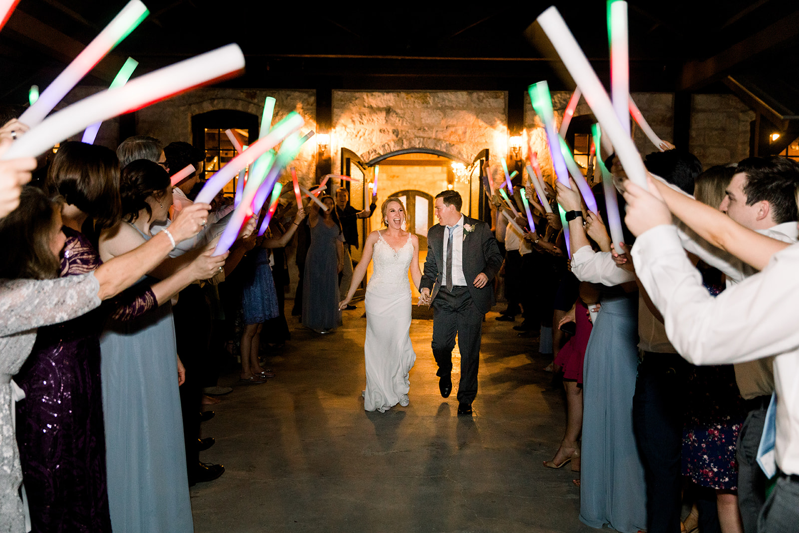Glow stick wedding exit: | Romantic blue Texas wedding at Spring Venue by Alexa Kay Events