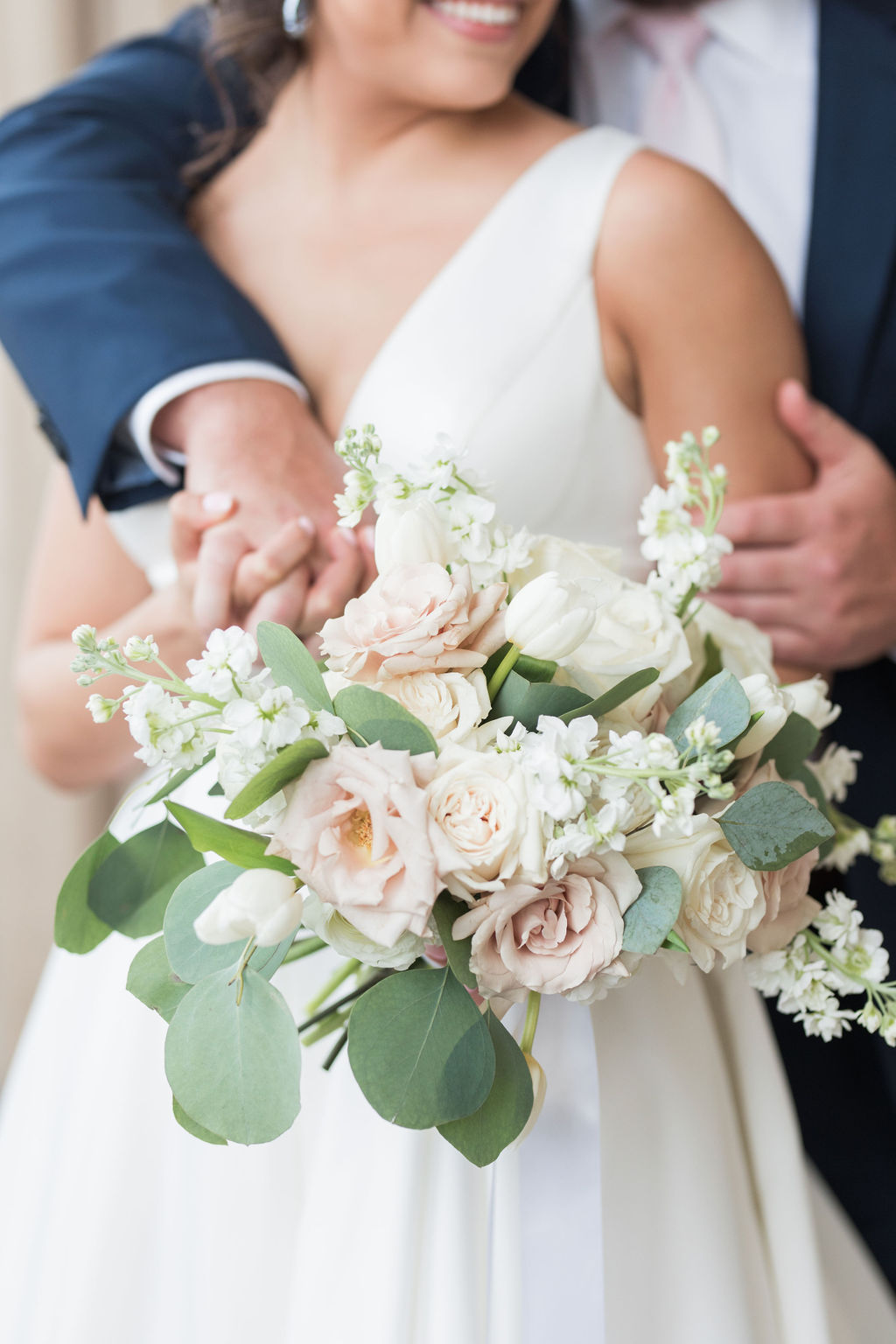 Ivory and blush wedding bouquet: Dusty Blue and Blush Wedding at The Room on Main featured on Alexa Kay Events!