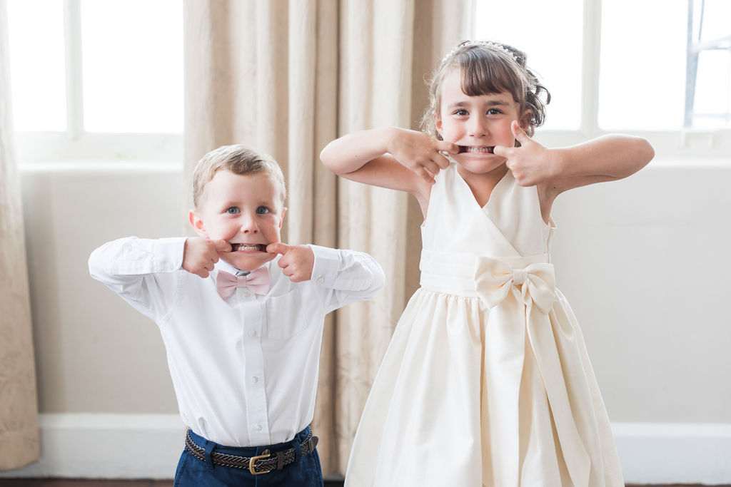 Flower girl and ring bearer: Dusty Blue and Blush Wedding at The Room on Main featured on Alexa Kay Events!
