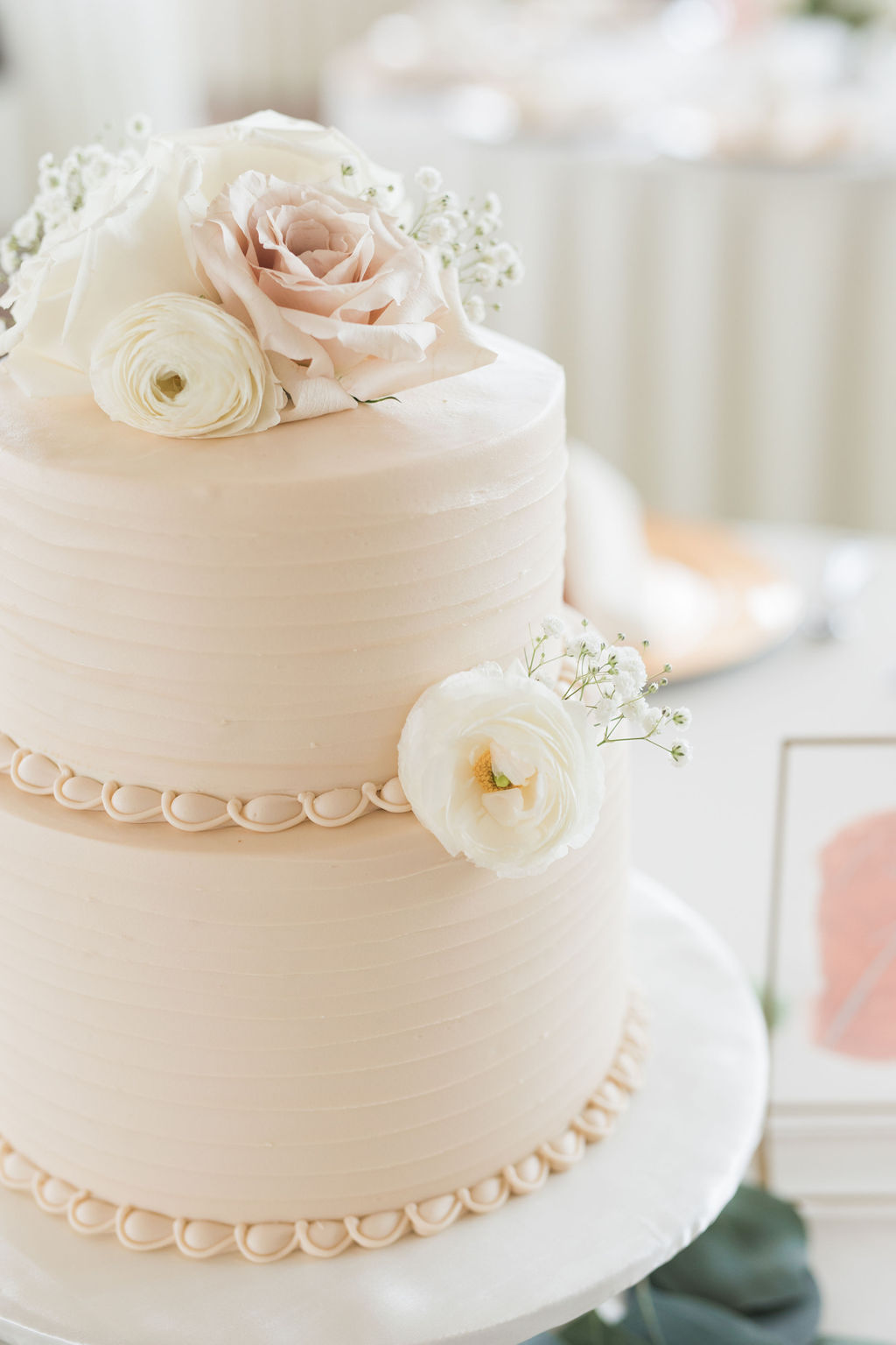 Ivory and blush wedding cake design: Dusty Blue and Blush Wedding at The Room on Main featured on Alexa Kay Events!