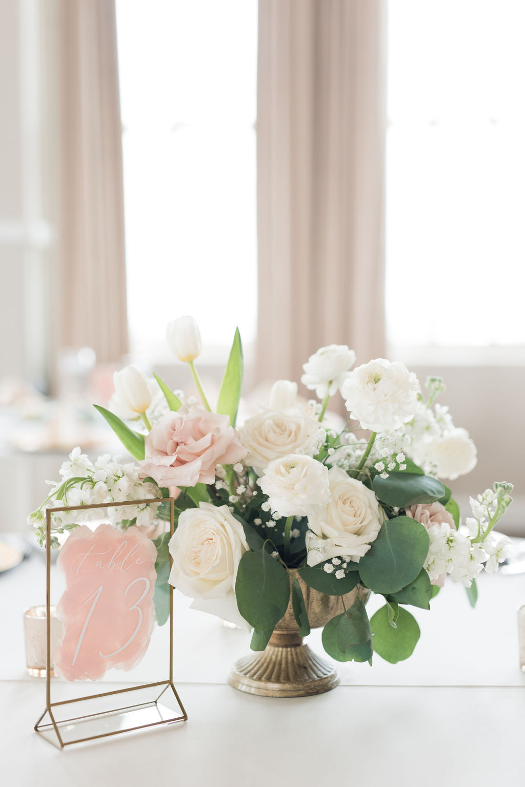 Ivory and blush wedding table decor: Dusty Blue and Blush Wedding at The Room on Main featured on Alexa Kay Events!