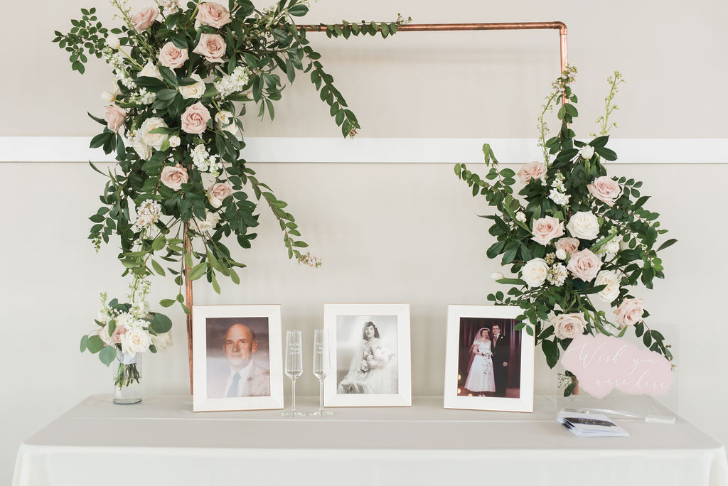 Wedding photo decor: Dusty Blue and Blush Wedding at The Room on Main featured on Alexa Kay Events!