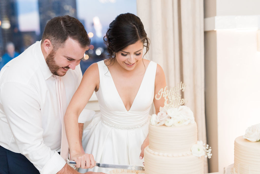 Wedding cake cutting: Dusty Blue and Blush Wedding at The Room on Main featured on Alexa Kay Events!