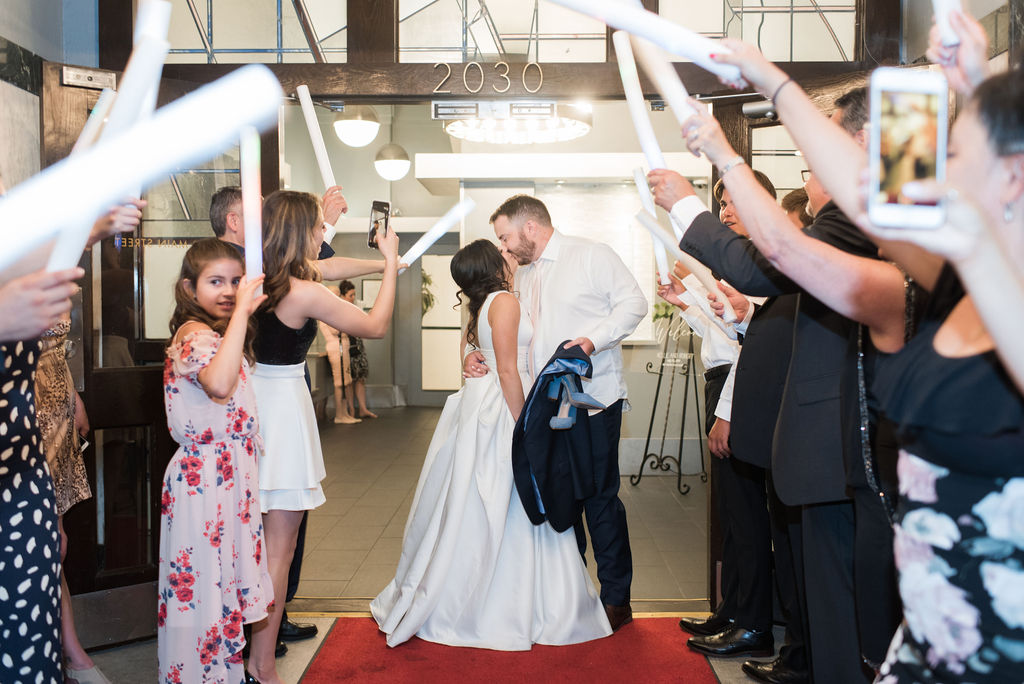 Wedding Exit Photo: Dusty Blue and Blush Wedding at The Room on Main featured on Alexa Kay Events!