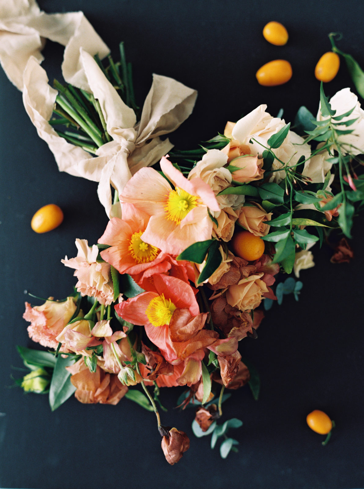 Bright peach and pink wedding flowers on Alexa Kay Events