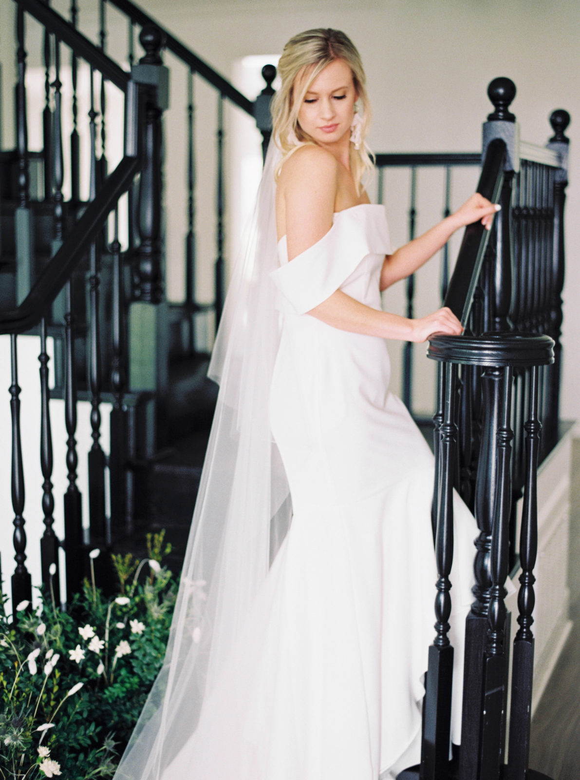 Bridal portrait with timeless off the shoulder wedding dress