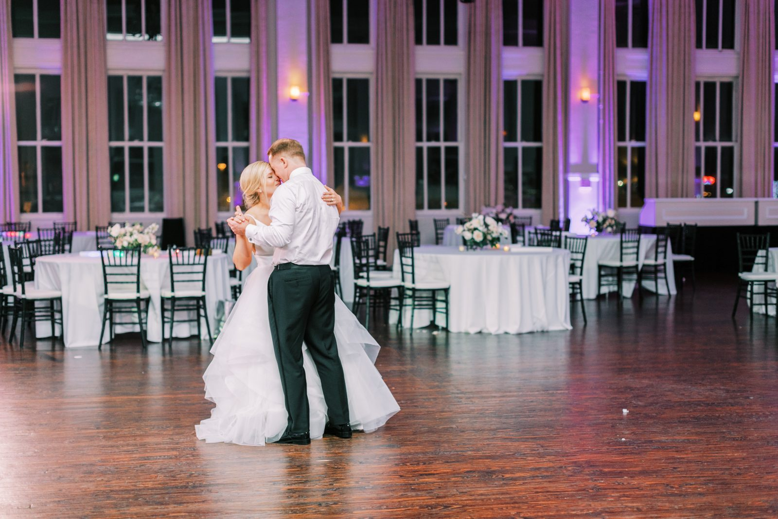 Bride and groom dancing at Room on Main wedding reception