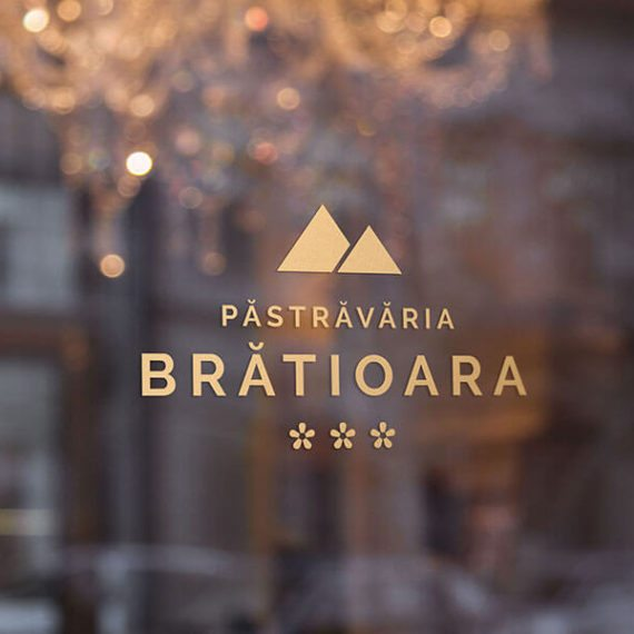 Logo Pastravaria Bratioara on a window, trout farm in the mountains, a relaxing place with amazing scenery.