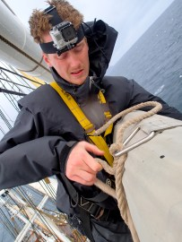 Wouter trying to untie the sail