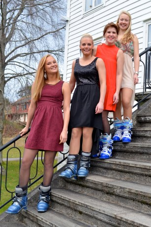 Ski gal's rocking the ski boots and dresses