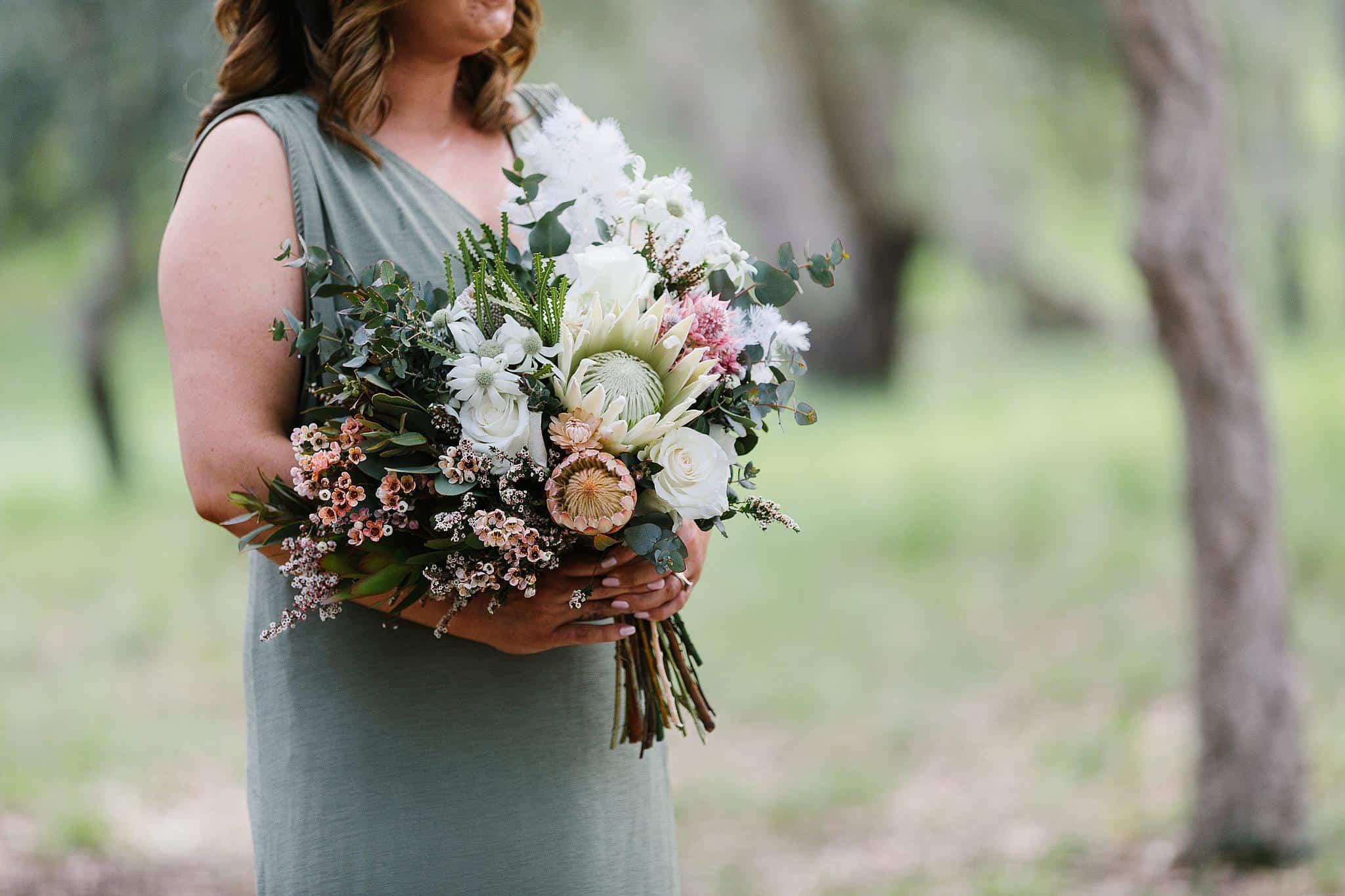 Bridesmaids holds bouquet