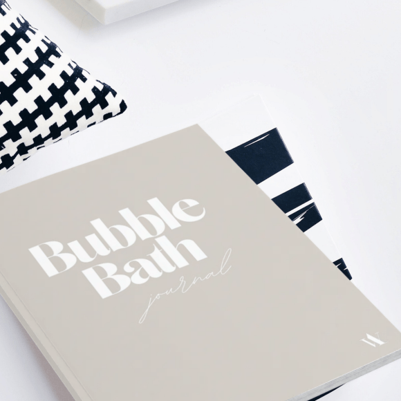 Image of the cover of the bubble bath journal / notebook. Cover in beige with a beautiful font on the cover in white.