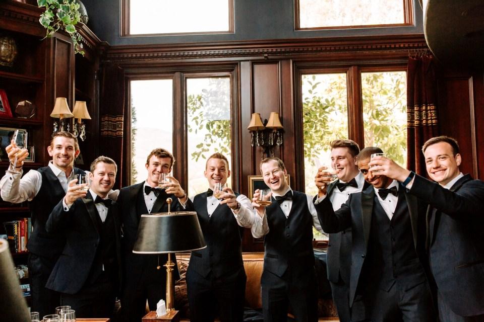 classy groomsmen drinking whiskey