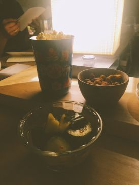 Snacks for starters. Popcorn, cucumber, and nuts