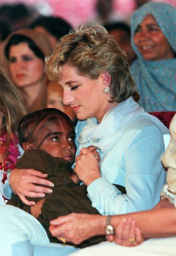 Diana comforting a child