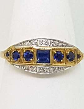square blue sapphire with 6 rounds sapphires on 9ct gold ring