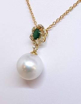 Pearl drop necklace with on gold chain and oval emerald